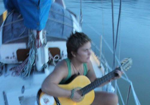 girl with guitar on boat